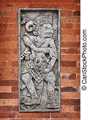 Mythological character on wall of the temple. Indonesia, Bali