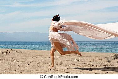 nő, a parton