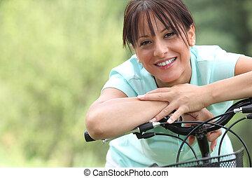 nő, bicikli