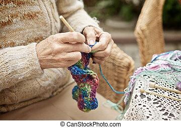 nő, kntting
