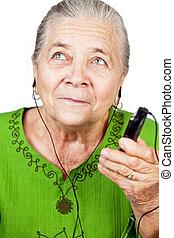 nő, mobile telefon, zene hallgat, idősebb ember