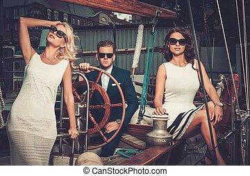 N - Stylish wealthy friends on a luxury yacht