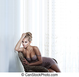 na moda, sensual, mulher bonita, posar, ligado, cadeira wicker, em, elegante, luminoso, sala, desgastar, lingerie sexy, olhar, câmera.
