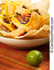 Nachos with beef, onions, peppers, and jalapeno and olive