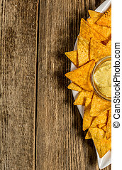 Nachos with cheese sauce - Traditional mexican nachos with...