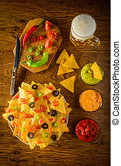 Nachos with dip and beer - nachos on a plate with salsa,...