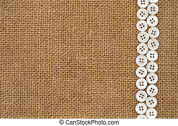 Nacre buttons on fabric texture background