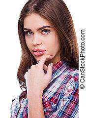 nadenkend, beauty., mooi, jonge vrouw , in, hemd, holdingshand, op, kin, en, kijken naar van fototoestel, terwijl, staand, tegen, witte achtergrond