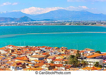 Nafplio or Nafplion, Greece, Peloponnese old town houses aerial panorama and snow mountains