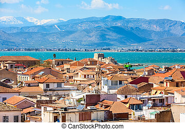 Nafplio or Nafplion, Greece, Peloponnese old town houses aerial panorama with sea and snow mountain peaks