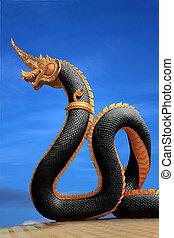 Naga statue of thailand with nice sky