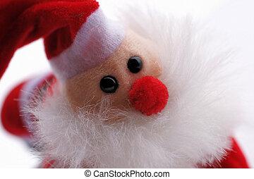 Nahaufnahme einer kleinen Weihnachtsmannpuppe