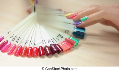 Nail art fashion design samples. Young woman hand with...