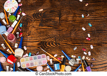 Nail art - Assorted nail art accessories on a wooden...
