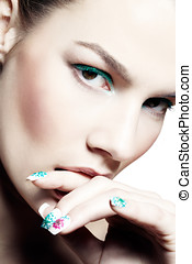 Nail Art - Closeup of a model with cyan eyeshadow and...