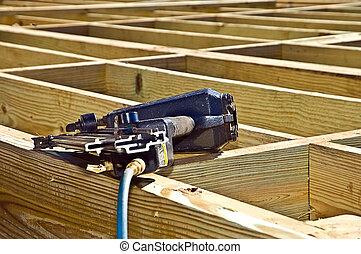Nail Gun at a Construction Site