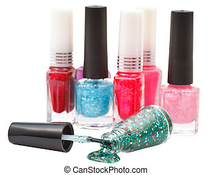 nail polish bottles and spilled lacquer isolated
