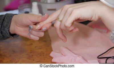 Nail polish correction base woman hands closeup