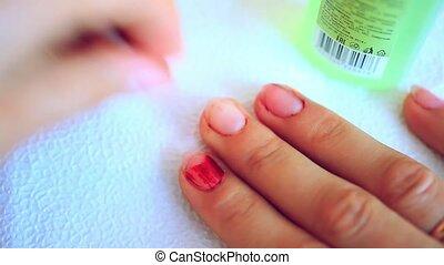 Nail polish remover, beauty salon, manicure.Treatment hand and nail care