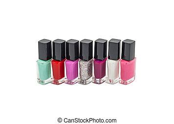 Nail polish row - Multi-colored bottles with nail polish...