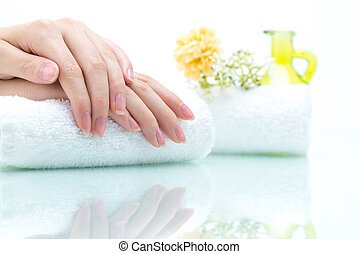 Nail salon - Hands on Towel with green Bottle and Flower