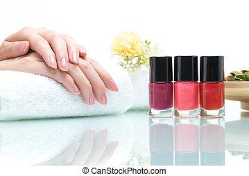 Nail salon - Hands on Towel with colorful Nail Polish