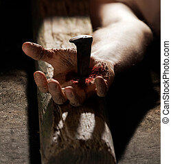 Hand nailed to the cross with blood and dirt