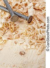 Nails and wood shavings closeup