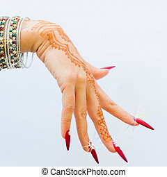 nails decorated with brilliant and hand with henna tattoos