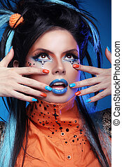 Nails Manicured. Make up. Close up of woman face with colorful makeup. Studio portrait