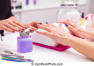 Nails saloon woman nail polish remove with tissue for new ...