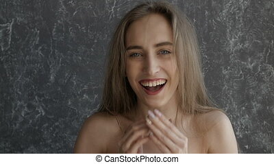 Naked attractive girl is laughing
