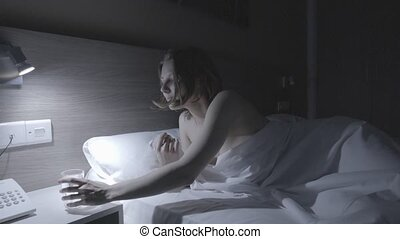 Naked attractive woman drinking water, turning off the light and going to sleep