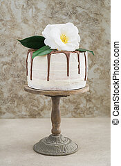 Naked drip wedding cake with camellias