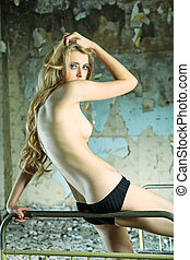 naked female - Beautiful lonely woman in the old house.