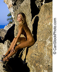 naked girl on rocks - blond girl with long hare and nice...