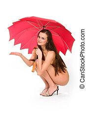 Naked girl under umbrella - The sitting naked girl under a...