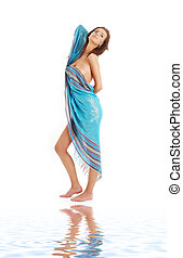 girl with blue sarong on white sand