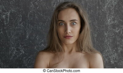 Naked gorgeous girl is surprised