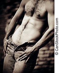 Naked male torso.