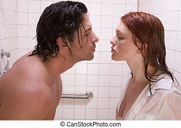 naked Man and woman in love are kissing in shower - Loving...