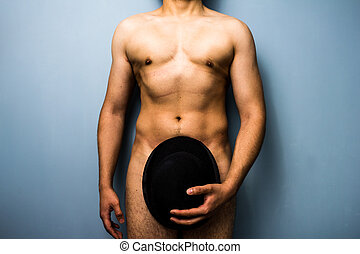Naked man hiding his modesty with a bowler hat