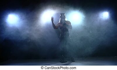 naked man in hat singing into a microphone, Slow motion, smoke