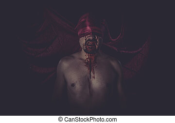 naked man on large red cloth over his eyes