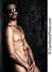 naked man - Sexual muscular nude man posing over dark...