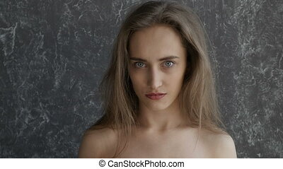 Naked pretty girl is surprised