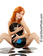 naked redhead with vinyl records over white