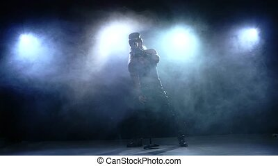 naked rock singer in hat singing into a microphone, Slow motion, smoke