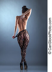Naked slim woman posing in tights, back to camera - Image of...