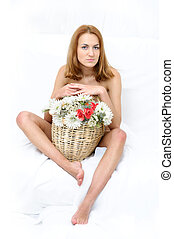 Naked woman with busket of flowers